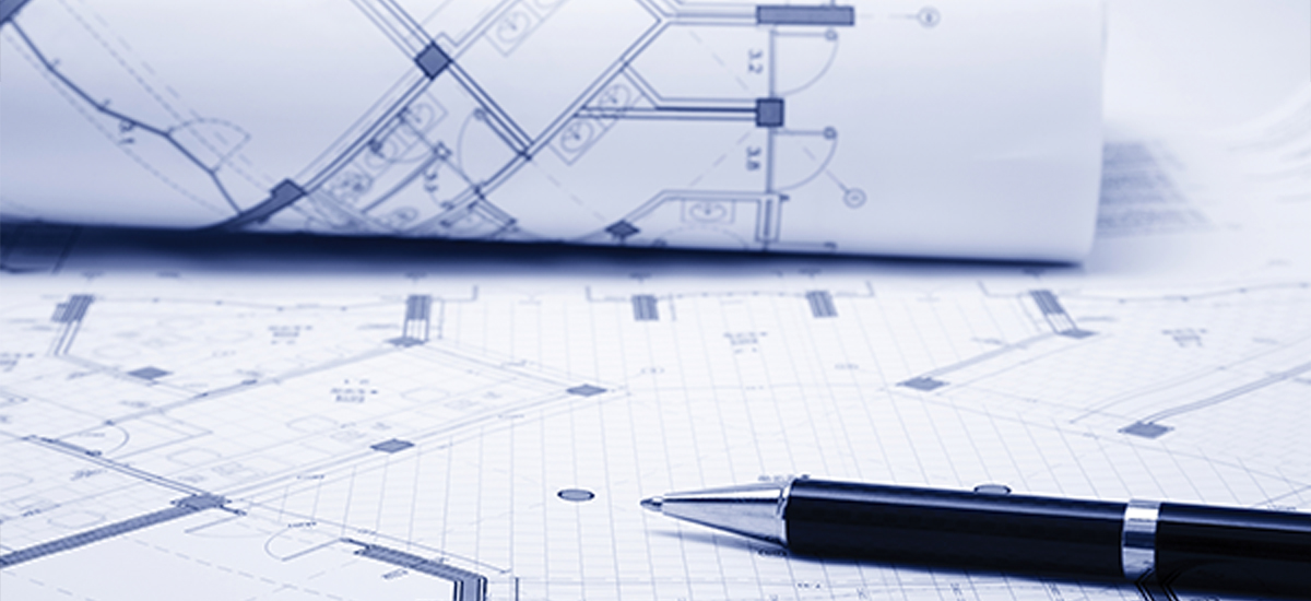 A Pen placed on a set of planning application documents and blueprints